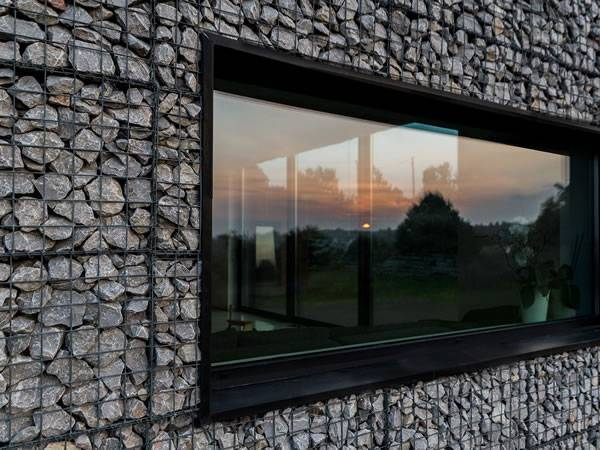 A studio with gabion around window.
