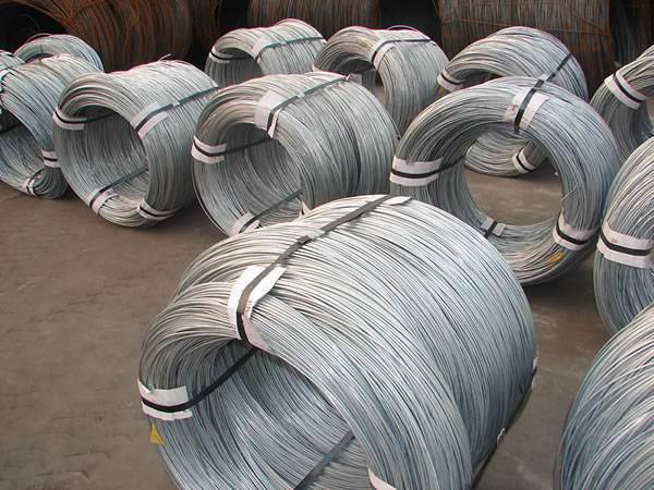 Several rolls of galvanized steel wires on the ground.