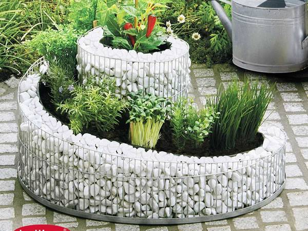 A curved planter landscape with several plants in it.