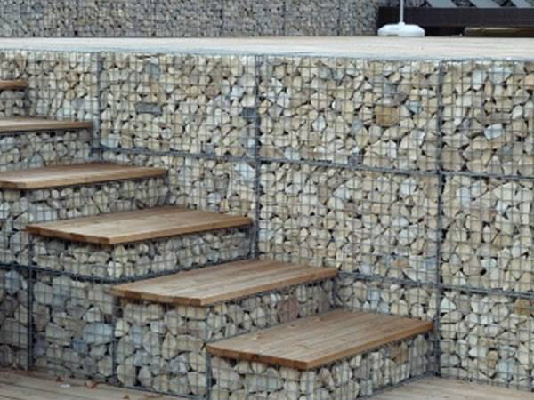 Gabion baskets are filled with rocks as steps and wall.
