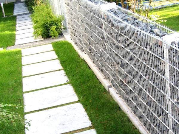 A line of welded gabion walls are installed in the garden.